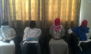Members of the Boko Haram splinter group attend a media conference in Maiduguri